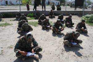 Afghan National Army recruits write their final literacy exams as part of their Basic Warrior course before proceeding to the next phase of their training, May 10, 2012.